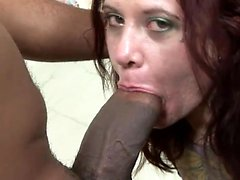 Tattooed babe has a black guy giving her the hard fucking she deserves