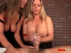 Busty masseuses giving handjobs