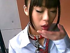 Japanese schoolgirl Chika is on her knees chained to a pole and forced to drink cum