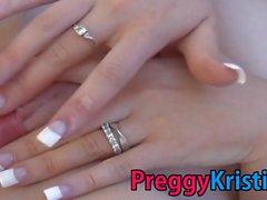 Preggy Kristi is fingering her moist pink pussy