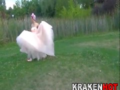 Hard Bride having fun outdoor. Public submission BDSM