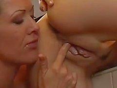 Two Lesbian Milfs Fuck In A Kitchen