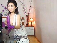 Asian teen beauty solo in bed