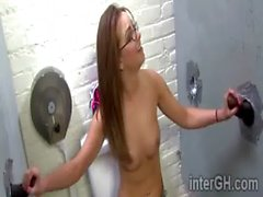 Nerdy beauty Pressley Carter sucks 2 shafts thru gloryhole in bathroom