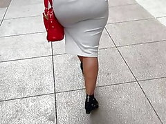 Big booty GILF in tight dress