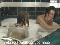 Two cute girls are bathing together and playing with pussy