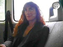 Old woman gives an handjob while masturbating in the car