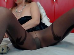 Sophie in pantyhose spreads her legs