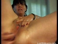 Sexy mature woman dildoing her ass and masturbates on webcam