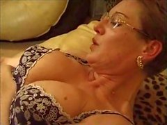 Mature with glasses pumped her horny pussy