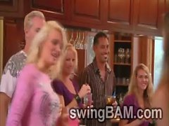 Couples exchange partners and try to live together in a swingers house
