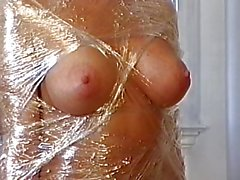 Big tits hottie wrapped in plastic and teased