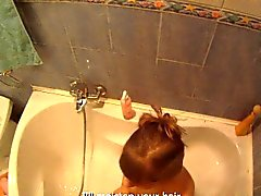 Skinny brunette with tiny tits blows a cock and gets her bald cunt fucked in the bath