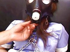 Dildo fisting asian bound in a gas mask