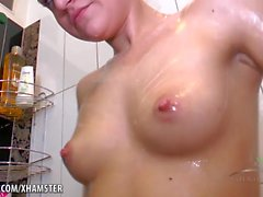 Mila soaps her hairy pussy in the shower