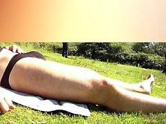 Sunbath in a field in brief that is black