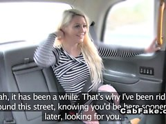 Blonde in fishnet pantyhose in fake taxi