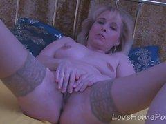 Mature blonde in stockings enjoys her masturbation session
