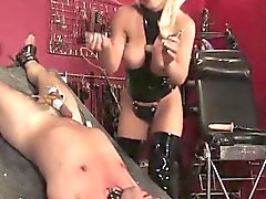 Busty femdom fucking a subs ass with a dildo