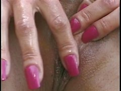 Long tongue dark lady strokes on a small dick