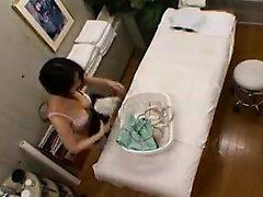 Japanese babe enjoys a hot oily massage with fingering