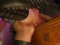 Sexy blonde dominatrix in corset and boots gets her beaver licked by slave girl