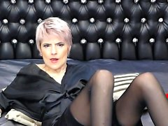 Short haired blonde milf in black stockings has some fun on