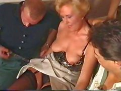 Mature German blonde takes on a couple of cocks and gets pounded