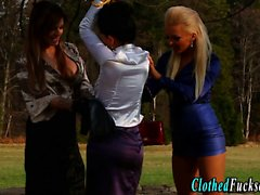 Clothed lesbians toying threesome