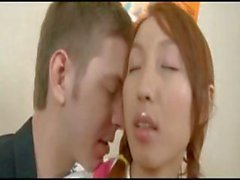 Young redheaded Asian chick sucks and fucks a big hard dick