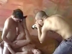Brunette sucks while being fucked by camera man