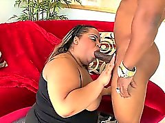 Horny black BBW sucking cock