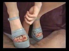 Mature slut in high heel shoes gives a nice footjob