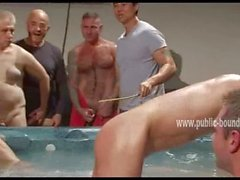 Old and young gays near a small inside pool spank boy preparing h