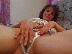 MILF amateur in crotchless panties plays