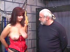 Brunette in a corset with blindfold gets her pussy tortured with clamps