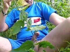 Outdoor with the stinging nettle in a Hummel sport shirt