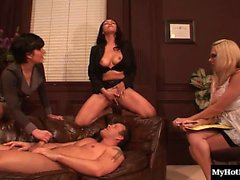 Three gorgeous babes surround a naked and prostrate Seth on