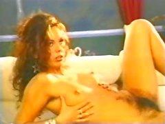 Sexy classic brunette star Sandra masturbates her unshaved pussy