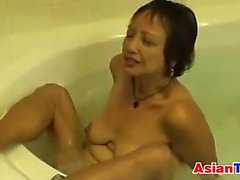 Asian GILF Masturbates In The Hot Tub