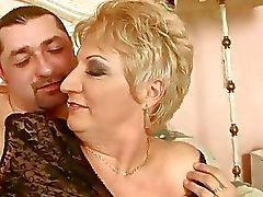 Grandma in fishnet stockings gets fucked