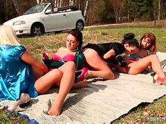4 girls having a pee party outdoors