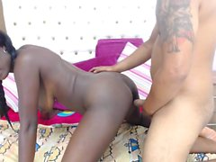 Bodacious black hottie with pigtails fucks a hard cock on t