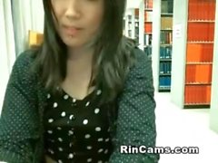 Asian undressing in library