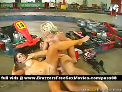 Two hot naked sluts on a car circuit get their wet pussy and ass fucked