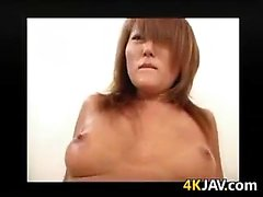 Asian Babe With A Shaved Pussy