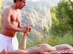 Masseur massages a beauties butthole before fingering her