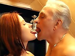 Young redhead macking blowjob to an old dick