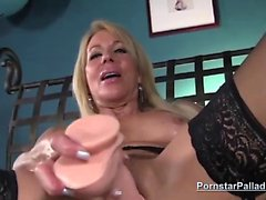 Erica Lauren tittyfucks a sex toy