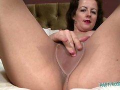 Brunette Feels Up Her Pantyhose Legs